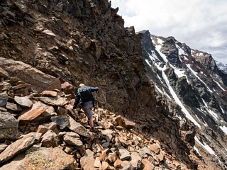 Crossing mountain peak while hiking from Pitztal glacier to Mittelberg